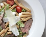 sliced steak arugula tomato pasta