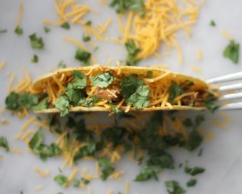 use a fork to keep a taco shell upright